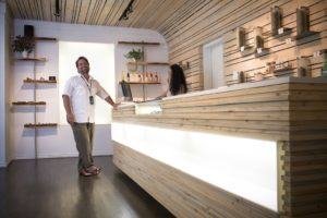 Novak carefully assists patients one-on-one at his Cannabis Boutique Groundswell.  Co-Owner Christian Butler designed the attractive and inviting space, which was built with local materials.