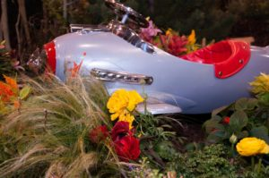 """Flowers and Flight"" - The entry garden, a 5,500-square-foot air- and space-themed oasis, displays aircraft from Wings Over the Rockies Air & Space Museum."
