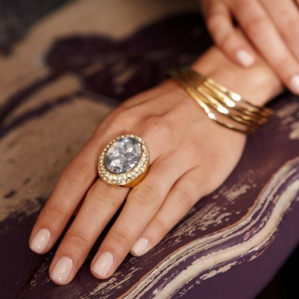 This oversized gem exudes femininity on a dainty hand.