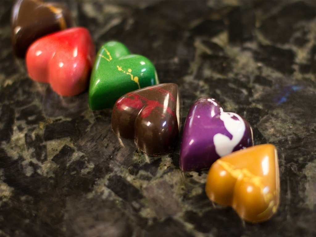 Valentine's Day six of hearts, from left to right: Kahlua caramel, rose caramel, rosemary caramel, port wine, lavender, dulcey blonde. Photo by Camille Breslin