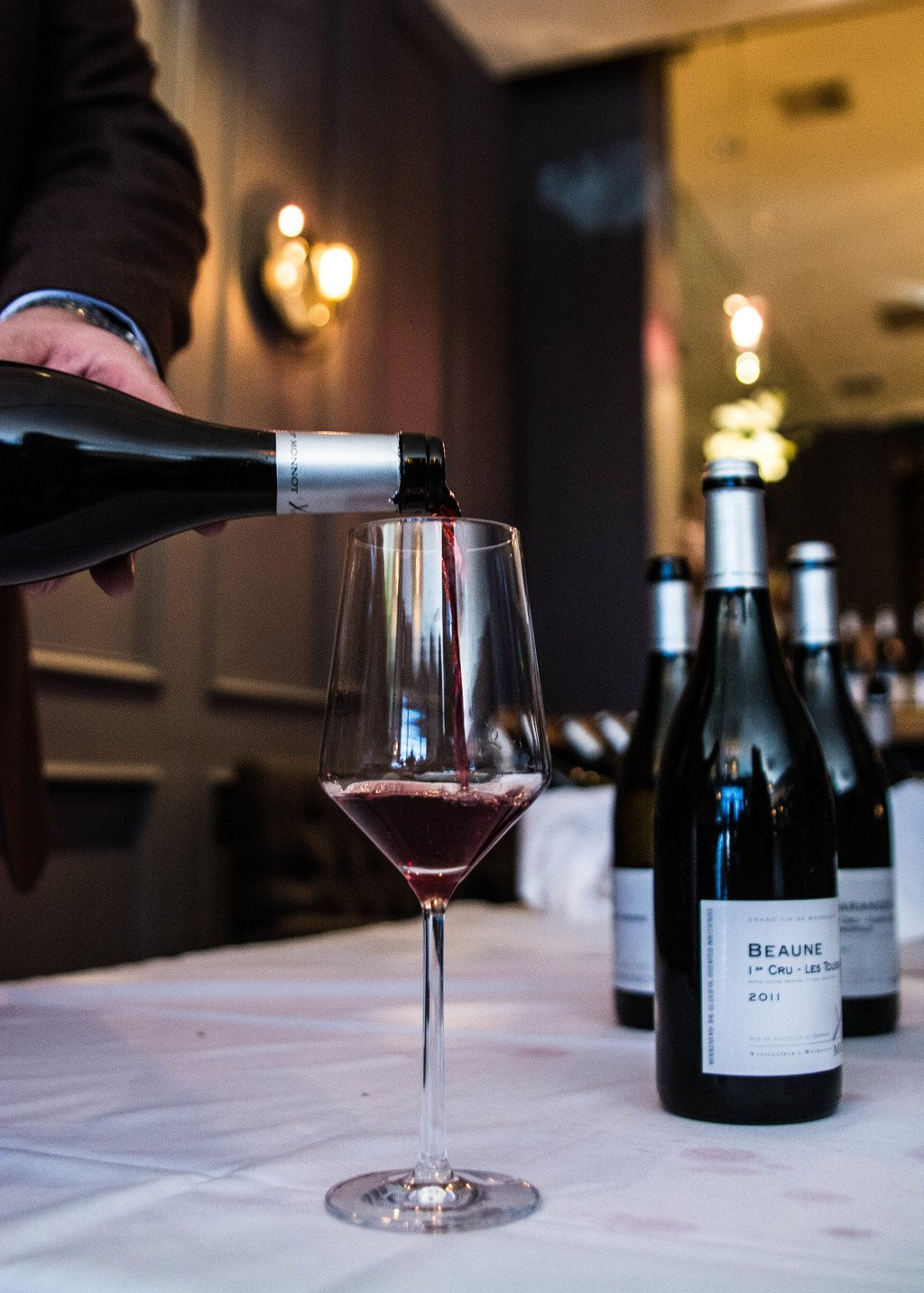 Xavier Monnot pours his Beaune 1er Touissants. Photography by Delmy Gooch.