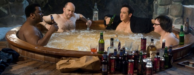 (Left to right) CRAIG ROBINSON as Nick, ROB CORDDRY as Lou, JOHN CUSACK as Adam, and CLARK DUKE as Jacob in Metro-Goldwyn-Mayer Pictures and United Artists' HOT TUB TIME MACHINE.