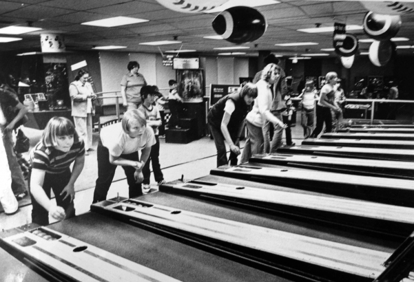 Kids playing skee ball at Celebrity Sports Center