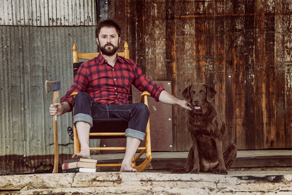 Adam Cayton-Holland with his dog